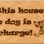 Dog in charge pine sign