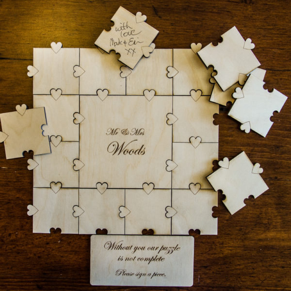 Laser-engraved wedding jigsaw guest book